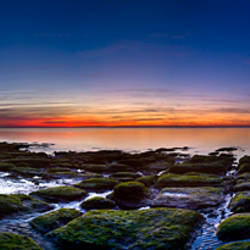 Rocks on the beach at sunset, Hunstanton, Norfolk, England