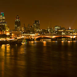 View of Thames River from Waterloo Bridge at night, London, England