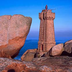 Lighthouse at a coast, Ploumanach Lighthouse, Cote De Granit Rose, Cotes-d'Armor, Brittany, France