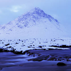 River with snowcapped mountain in the background, River Etive, Buachaille Etive Mor, Rannoch Moor, Highlands, Scotland