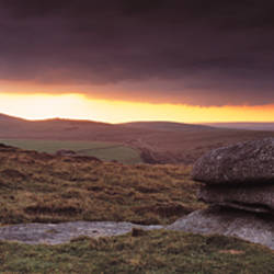 Bright horizon with dark clouds from Higher Tor, Dartmoor, Devon, England
