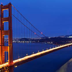 Suspension bridge lit up at dusk, Golden Gate Bridge, San Francisco, California, USA