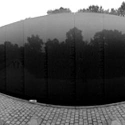 Tourist at a memorial, Vietnam Veterans Memorial, Washington DC, USA