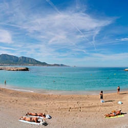 Tourists sunbathing on the beach, Prado Beach, Marseille, Bouches-du-Rhone, France