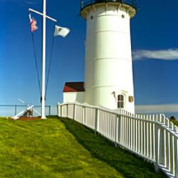 American flags near a lighthouse, Nobska Light, Woods Hole, Cape Cod, Barnstable County, Massachusetts, USA
