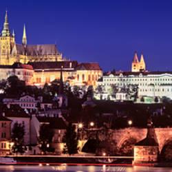 Arch bridge across a river, Charles Bridge, Hradcany Castle, St. Vitus Cathedral, Prague, Czech Republic