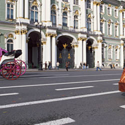 Couple in costumes posing in front of a museum, Hermitage Museum, Winter Palace, Palace Square, St. Petersburg, Russia