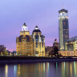 Buildings lit up at night, Swissotel Krasnye Holmy Hotel, Moskva River, Moscow, Russia