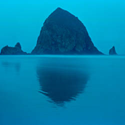 Reflection of rock in water, Haystack Rock, Cannon Beach, Clatsop County, Oregon, USA