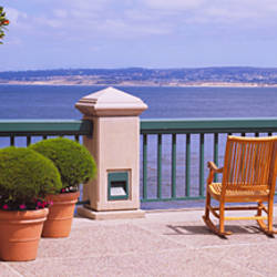Chairs and potted plants on a deck, Monterey Bay, California, USA