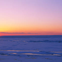 Sunset over a frozen lake, Lake Erie, New York State, USA