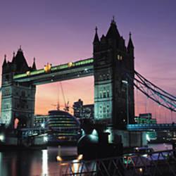 Drawbridge lit up at dusk, Tower Bridge, Thames River, London, England