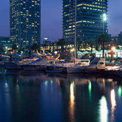 Low angle view of buildings lit up at the waterfront, Torre Mapfre, Hotel Arts, Port Olimpic, Barcelona, Catalonia, Spain