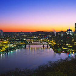 Buildings lit up at dawn, Pittsburgh, Pennsylvania, USA