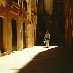 Woman walking in an alley, El Borne, Barcelona, Spain