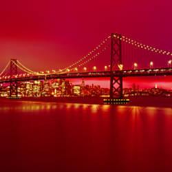 Suspension bridge lit up at night, Bay Bridge, San Francisco, California, USA