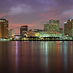 Buildings lit up at the waterfront, New Orleans, Louisiana, USA