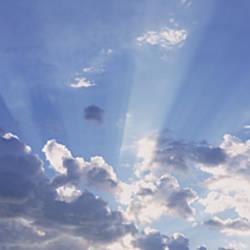 Sunbeams shining through clouds