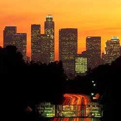 Skyscrapers lit up at dusk in a city, Los Angeles, California, USA