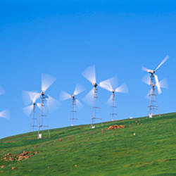 Low angle view of wind turbines on a hill, Altamont Pass, California, USA